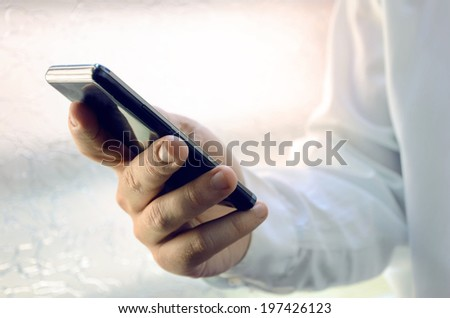 Close up of a businessman using mobile phone     - stock photo