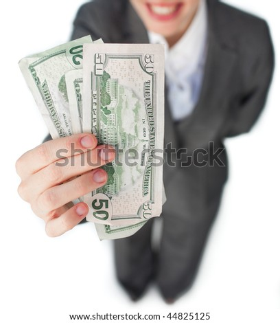 Close-up of a businesswoman showing bank notes against a white background - stock photo