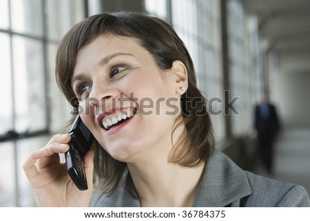 Close-up of a businesswoman talking on a mobile phone - stock photo