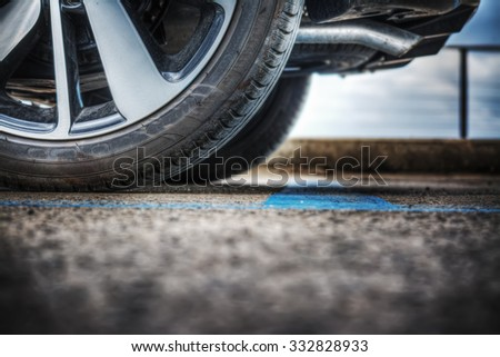close up of a car wheel on the ground - stock photo