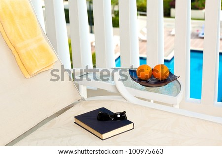Close up of a chaise lounge in a resort - stock photo