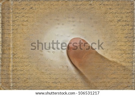 close up of a child reading braille - stock photo