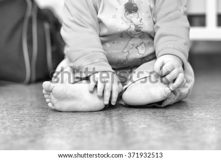 Close-up of a child's foot. Selective focus - stock photo