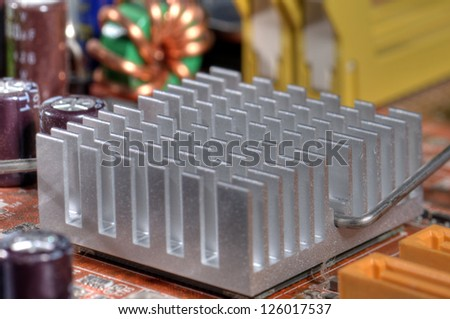 Close up of a chipset heatsink on motherboard - stock photo