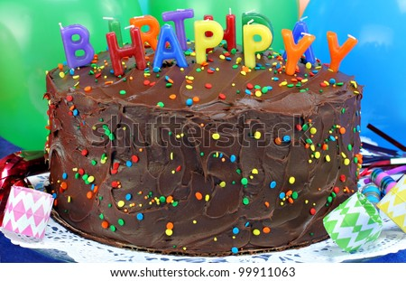 Close up of a chocolate birthday cake with Happy Birthday candles, selective focus on candles. - stock photo