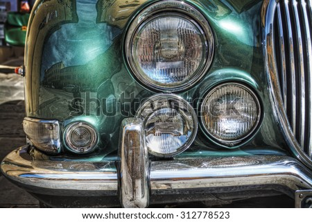 close up of a classic car front view in hdr tone mapping effect - stock photo