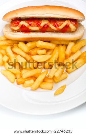Close up of a classic hot dog with mustard and ketchup and french fries on a white plate - stock photo