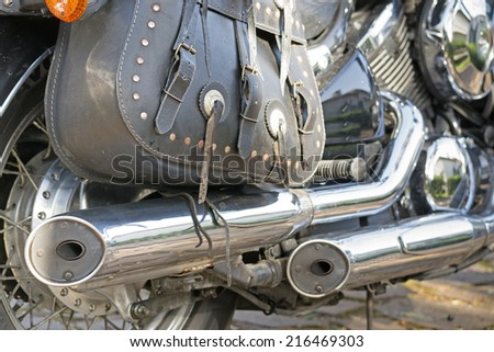 close up of a classic motorcycle exhaust - stock photo