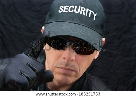 Close-up of a close protection officer gives warning. - stock photo