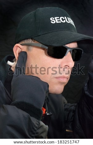 Close-up of a close protection officer searching for a specific threat. - stock photo