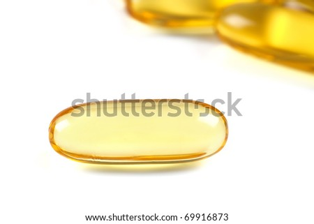Close up of a  cod liver fish oil capsule, a nutritional supplement high in omega-3 fatty acids, EPA,  DHA, and  high levels of vitamin A and vitamin D. - stock photo