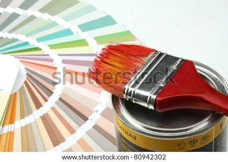 Close-up of a color palette, brush, paint on white background - stock photo