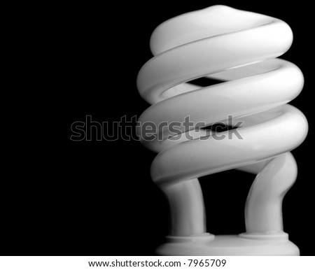 Close-up of a compact fluorescent light (CFL) bulb on black background - stock photo