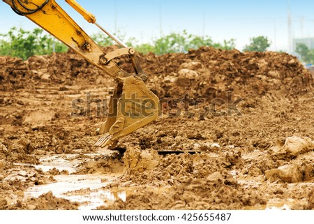 Close-up of a construction site excavator - stock photo