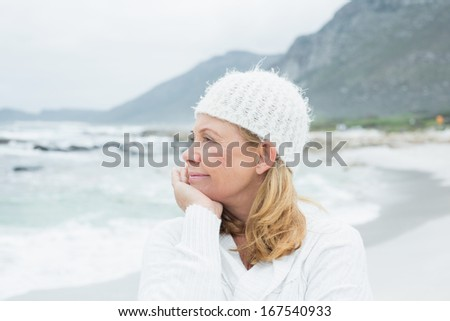 Close-up of a contemplative casual senior woman relaxing at the beach - stock photo