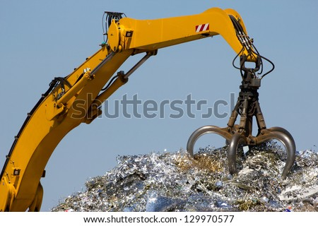 Close-up of a crane for recycling metallic waste - stock photo