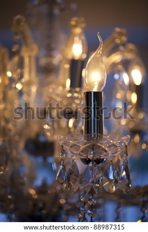 Close-up of a crystal chandelier, selective focus and intentional blur. - stock photo