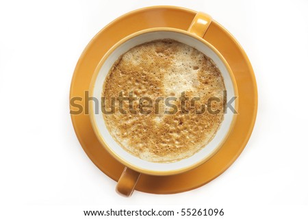 Close-up of a cup of coffee with froth. Focus is on the froth. - stock photo