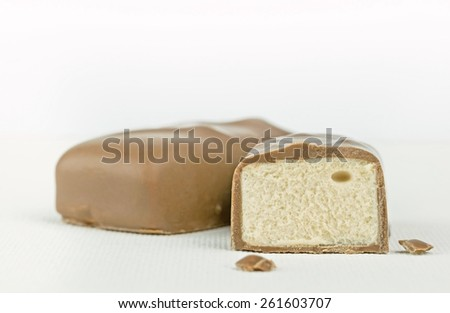 Close up of a cut milk chocolate candy bar with copy space for your text - stock photo