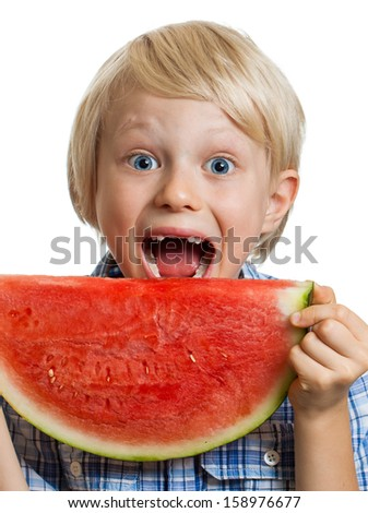 Close-up of a cute happy smiling boy about to take a bite of  juicy slice of watermelon. Isolated on white. - stock photo
