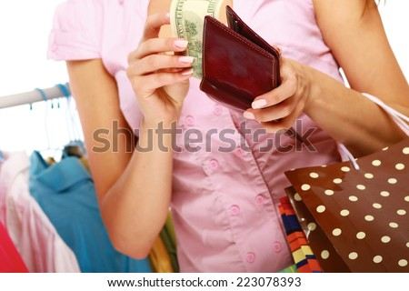 Close-up of a cute woman paying with her credit card in a shop. - stock photo