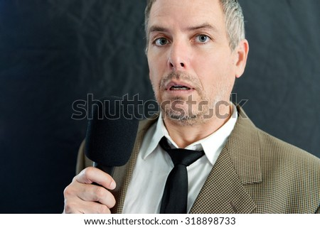 Close-up of a depressed man speaking into microphone. - stock photo