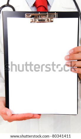 Close-up of a doctor showing blank clipboard to write it on your personal message or advice - stock photo