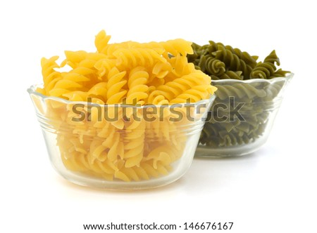 close up of a dried italian pasta in bowl on white background  - stock photo