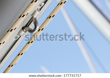 Close up of a fasten rope. details yacht - stock photo