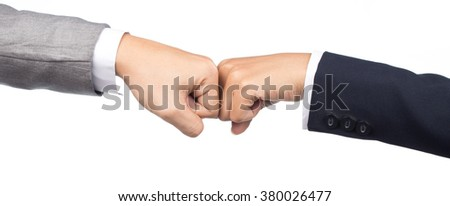 close up of a fist bump against  isolated on white background - stock photo