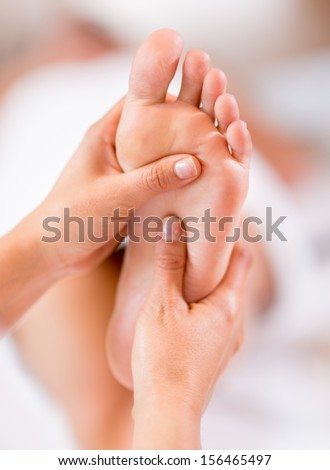 Close up of a foot massage at the spa  - stock photo
