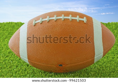 Close up of a football over green grass - stock photo