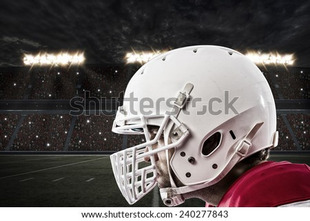 Close up of a Football Player with a red uniform on a stadium. - stock photo