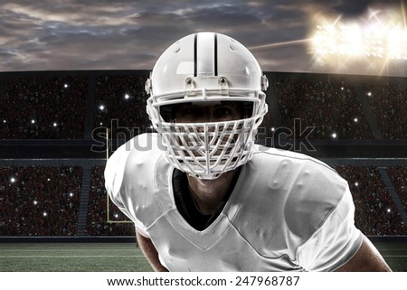 Close up of a Football Player with a white uniform on a stadium. - stock photo