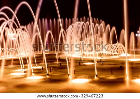 Close up of a fountain at night with lights in Baku Azerbaijan. - stock photo