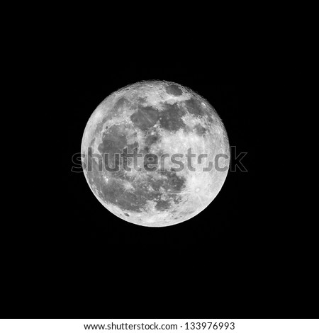Close up of a full moon in January 2011 against a black background - stock photo