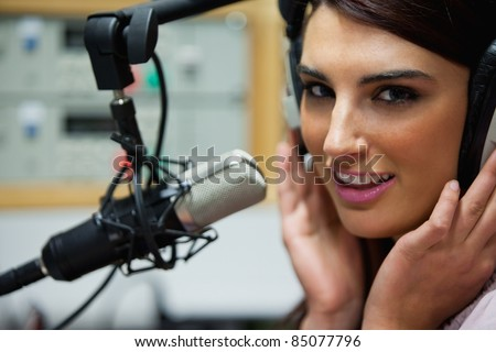 Close up of a gorgeous woman posing in a studio - stock photo