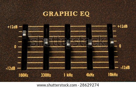 Close up of a graphic equalizer on a electric guitar amp. - stock photo