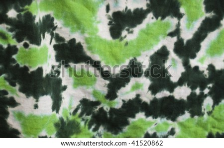 Close-up of a green tie-died t-shirt - stock photo