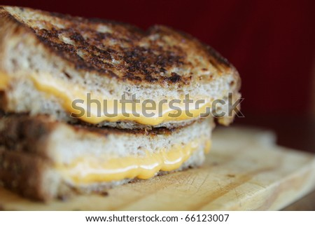 Close up of a grilled cheese with melted cheese - stock photo