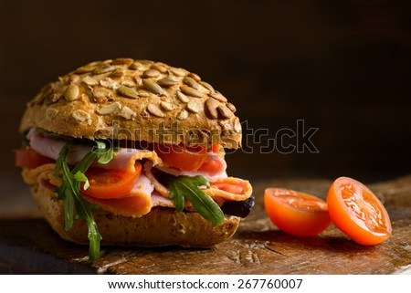 Close up of a ham salad roll with creative lighting - stock photo
