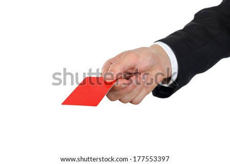 Close up of a hand giving credit card - stock photo