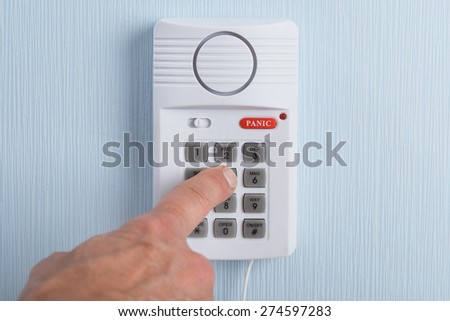 Close-up Of A Hand Pushing Button In Security System - stock photo
