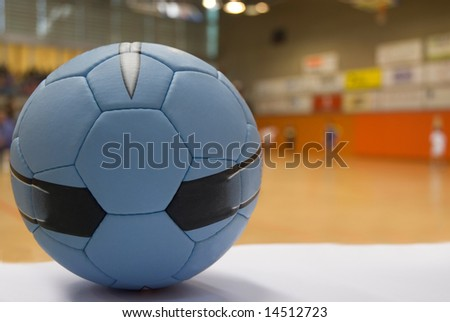 Close up of a handball ball, players out of focus at the background - stock photo