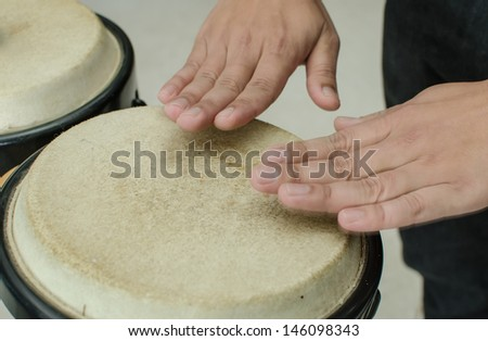 Close up of a hands beating a drum - stock photo