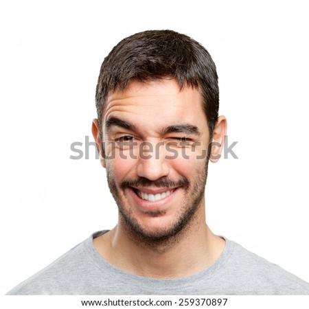Close up of a happy man winking an eye - stock photo