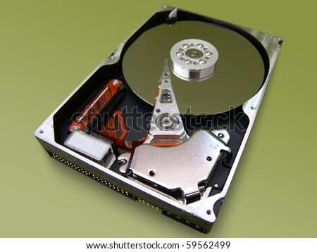 Close up of a hard disk drive on a green background - stock photo