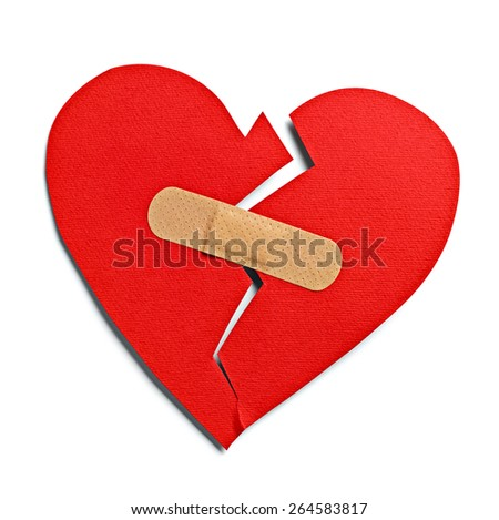 close up of a heart shape with bandage on white background - stock photo