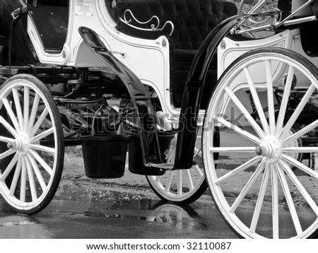 close up of a horse drawn carriage in black and white - stock photo