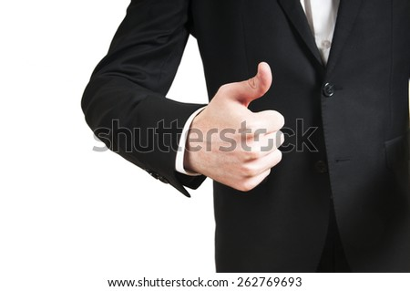 Close-up of a human hand showing thumbs up on the foreground - stock photo